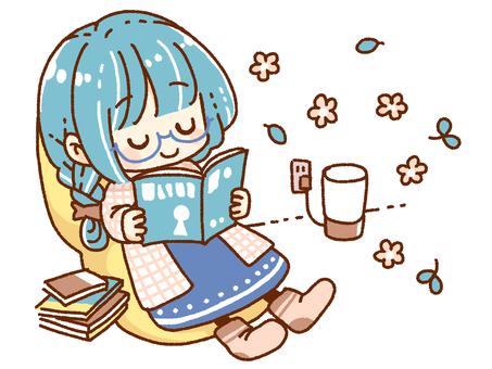 アロマをたきながら読書をする女の子