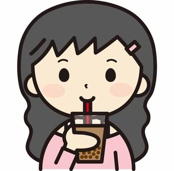 Woman drinking tapioca milk tea