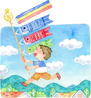 一個男孩跑著鯉魚旗