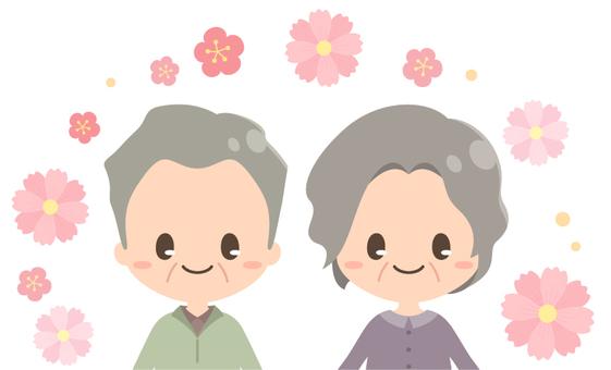 敬老の日の夫婦とコスモス_上半身