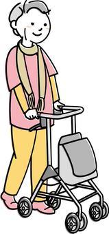 Senior woman holding a wheelbarrow