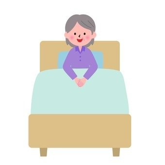 The grandmother sitting on the bed