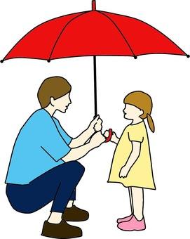 Parent and child holding an umbrella