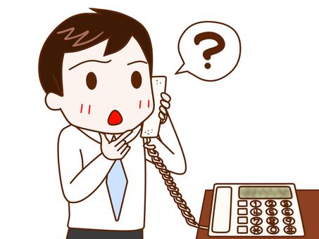電話で疑問を持つサラリーマン