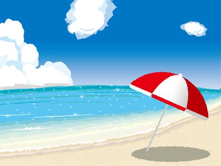 Sandy beach and umbrella