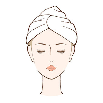 Face of a woman wearing a towel