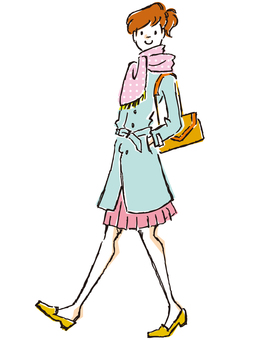 A woman in a spring color coat
