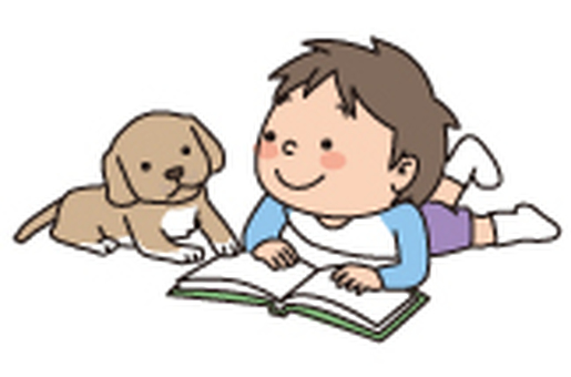A boy reading with a puppy