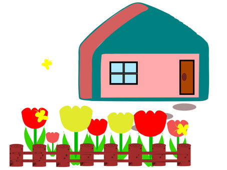 Bright spring house where tulips bloom in the garden