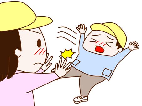A girl pushing a boy