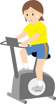 A woman riding an aero bike