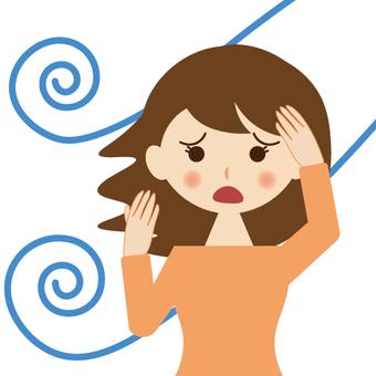바람에 머리카락이 흐트러진 여성