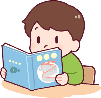 A boy reading a book on deep-sea fish