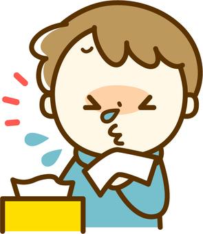 A boy sneezing