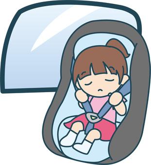 Girl sleeping on child seat