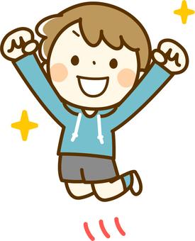 점프를하고 기뻐하는 소년