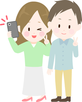 Illustration of a man and a woman taking a picture with a smartphone