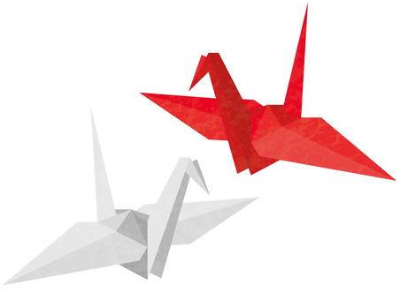 Red and white folded crane with spread wings