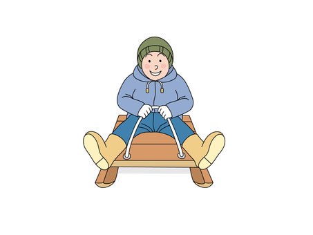 A boy riding a sled