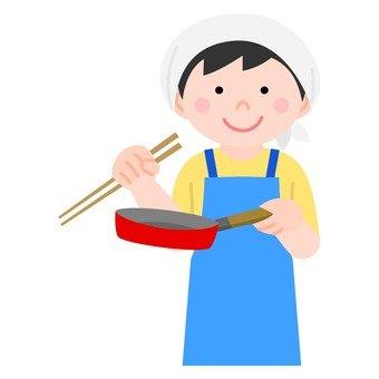 Men cooking in a frying pan