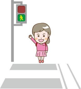 A girl crossing a pedestrian crossing