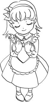 A girl holding a heart