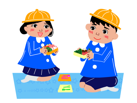 Kindergarten child showing lunch box