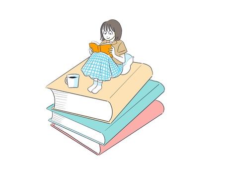 コーヒーを飲みながら読書する女の子