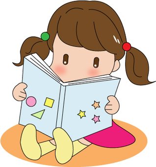 A girl reading a picture book