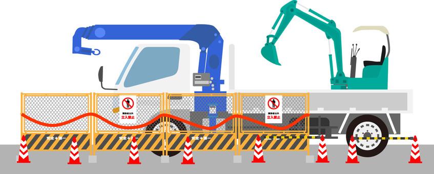 Construction site crane truck and excavator