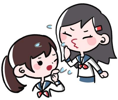 A girl sneezing