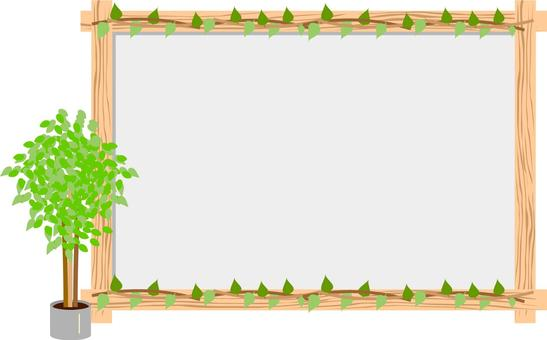 Houseplant and wooden frame