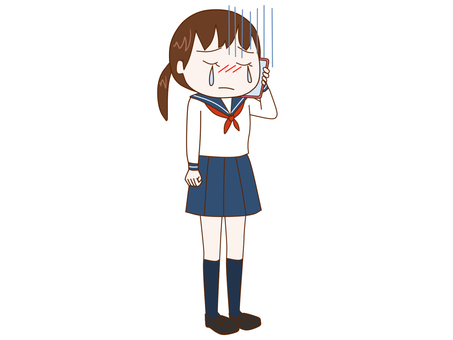 Female student talking while crying on a smartphone