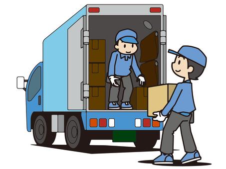 トラックに荷物を積み込む引越し業者