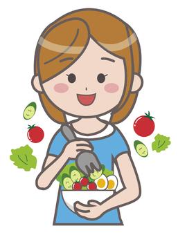 一個女人在吃蔬菜