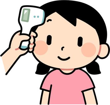 Girl measuring body temperature