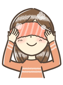 A woman warming her eyes with a hot towel