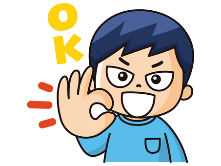 A boy giving an ok sign