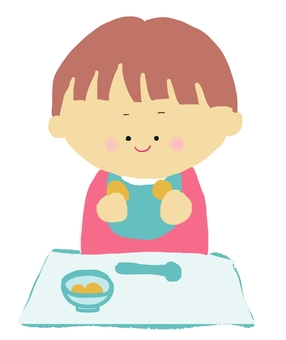 Toddler eating rice with a hand