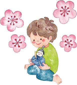 A boy holding a hina doll