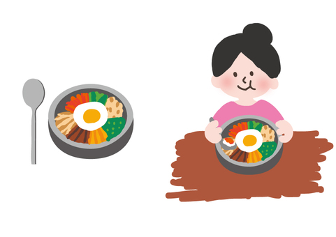 A woman eating bibimbap