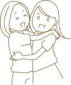 Two people rejoicating and hugging