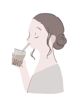 Woman drinking tapioca milk tea