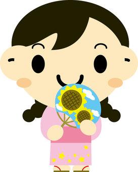A girl with a fan of Sunflower wearing a Yukata