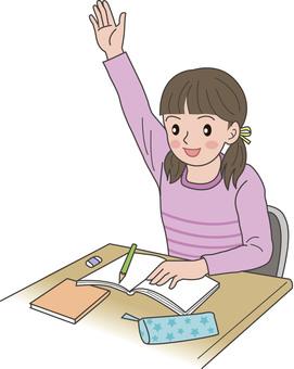 A girl raising her hand