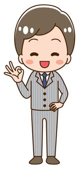 Man in suit OK pose