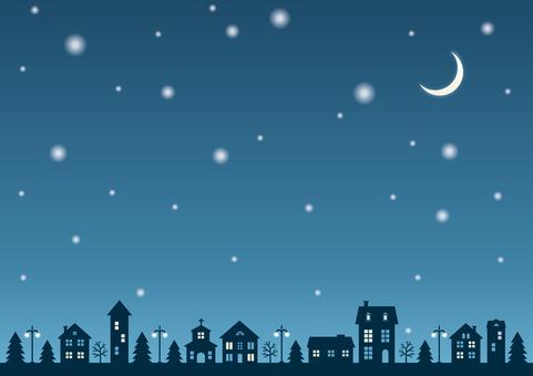 雪降る夜の町の背景