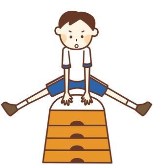 跳び箱をする体操着の男の子