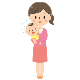 Mother holding a crying baby