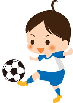 A boy kicking a soccer ball